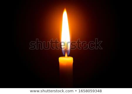 Stockfoto: Beautiful Candles Burning On A Black Background