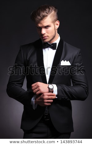 elegant business man fixing his collar  Stock photo © feedough