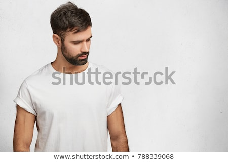 Stock photo: young hipster man looking down.