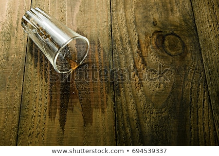 spilled glass of whiskey on the table  Stock photo © OleksandrO