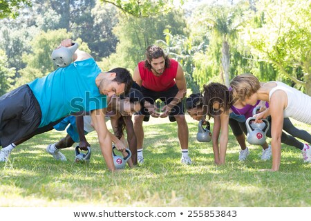 Fitness group planking in park with coach Stock photo © wavebreak_media