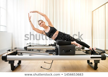 Pilates reformer woman mermaid exercise Stock photo © lunamarina