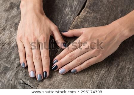 Hermosa manos miniatura pintado esmalte de uñas mujer Foto stock © bezikus