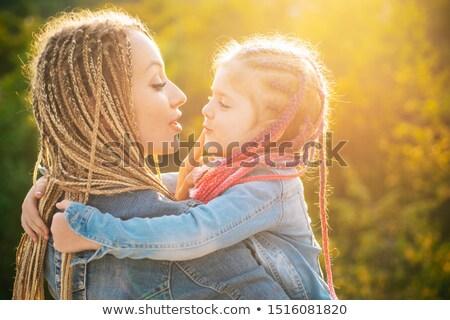 Családi portré naplemente portré szülők fiú szabadtér Stock fotó © igabriela