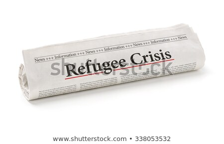 Rolled newspaper with the headline Refugee Crisis Stock photo © Zerbor
