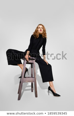 Girl in overalls with legs spread Stock photo © svetography
