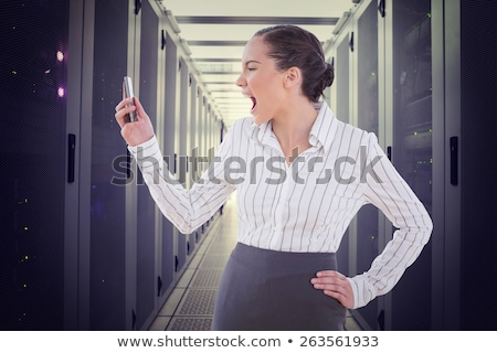 Composite image of angry businesswoman screaming at her phone Stock photo © wavebreak_media