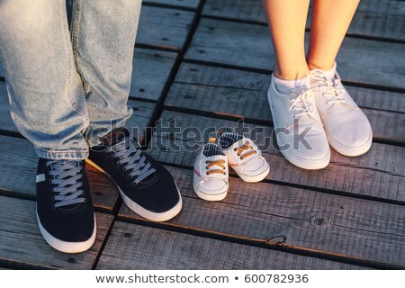 portrait of young man with shoes for a baby Stock photo © phbcz
