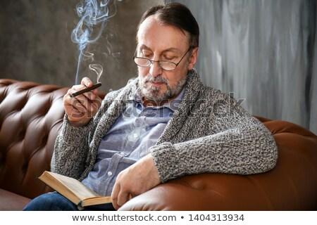 Középkorú férfi dohányzás arc háttér portré nyakkendő Stock fotó © zurijeta