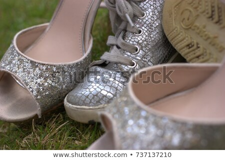 Sparkly toe of a gold fashionable high-heeled shoe Stock photo © sarahdoow