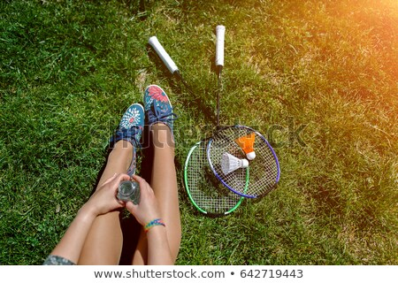 Jambes badminton raquette herbe verte femme herbe Photo stock © user_9834712