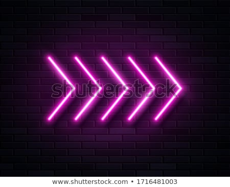 Neon arrow on a black background stock photo © Natali_Brill
