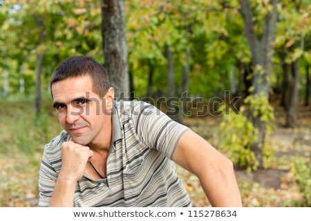 Stock photo: Middle aged man in distress with hand on forehead