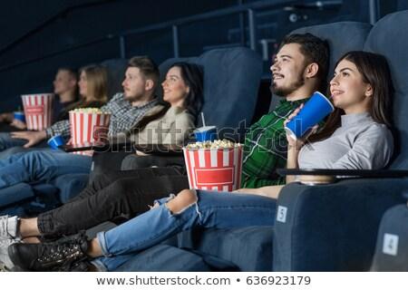 Couple love in cinema theater watching movie Stock photo © orensila