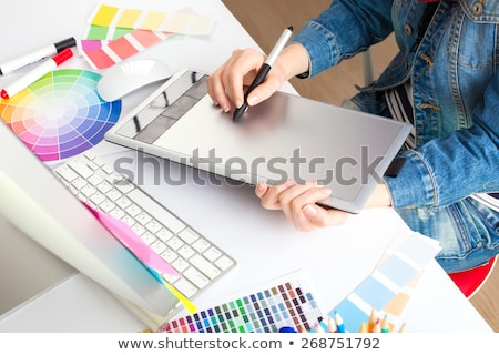 Graphic designer drawing something on graphic tablet at the home Stock photo © vlad_star