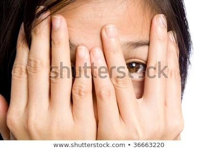 Beautiful asian model covering eyes with hands. Stock photo © deandrobot