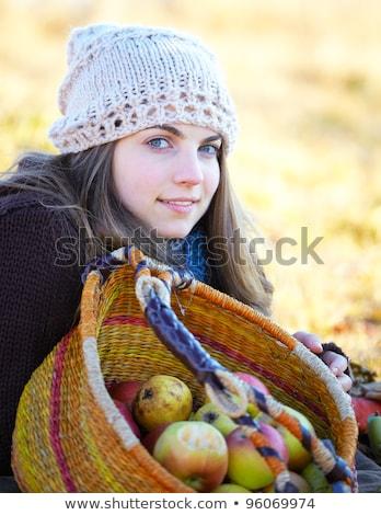 Függőleges kép higgadt nő kosár fej Stock fotó © deandrobot