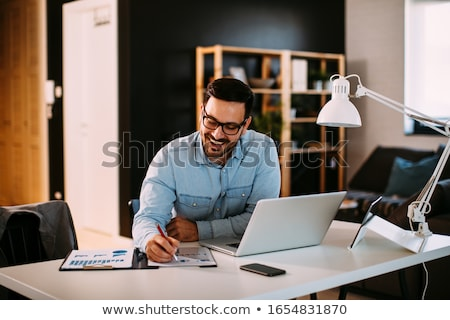 handsome young man working from home office stock photo © vlad_star