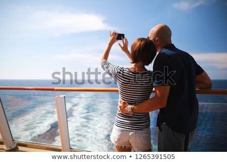 man taking couple photo on mobile phone in balcony stock photo © wavebreak_media