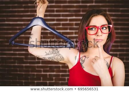 Verward vrouw hanger muur portret Stockfoto © wavebreak_media