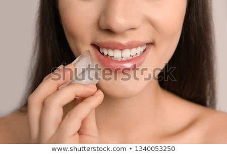 Ice cube in woman's mouth. Stock photo © Fisher