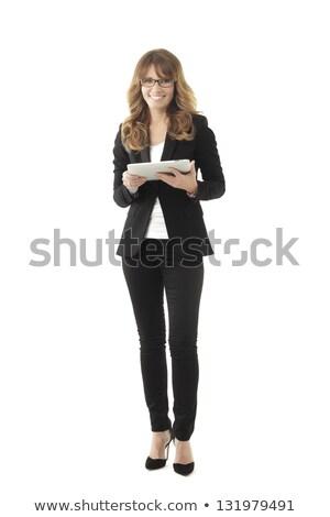 Coup femme comprimé jeunes femme souriante permanent Photo stock © deandrobot