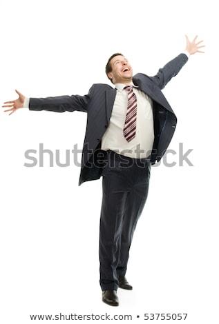 Businessman standing with raised arms up. Stock photo © RAStudio