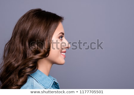close up side view of smiling brunette woman stock photo © deandrobot