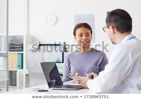Man vergadering tegenover vrouw kantoor vergadering Stockfoto © IS2