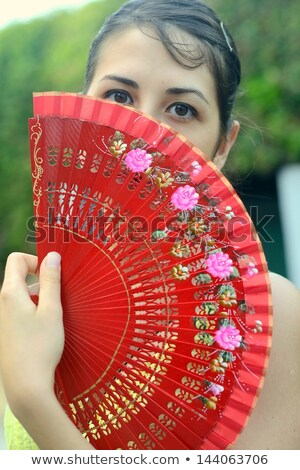 mysterious woman holding a fan black and white Stock photo © zdenkam