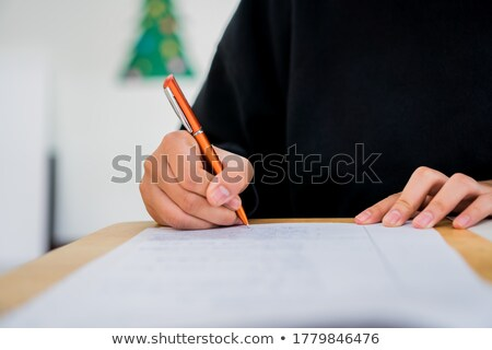 businesswoman reading binder in office stock photo © is2