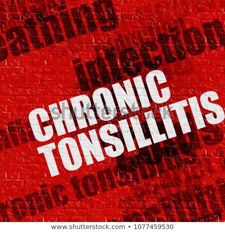 Medicine concept: Chronic Tonsillitis on the Red Brickwall . Stock photo © tashatuvango