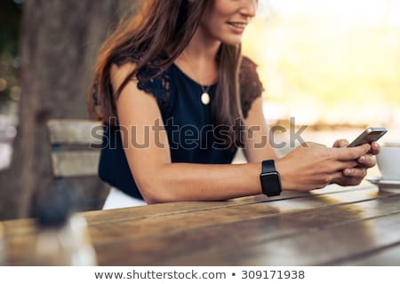 Smiling woman typing a text message Stock photo © Giulio_Fornasar