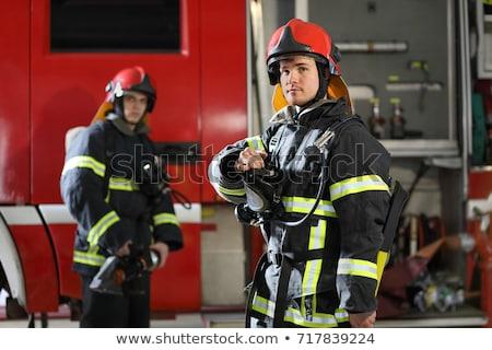 Strażak człowiek zestaw różny książki Internetu Zdjęcia stock © toyotoyo
