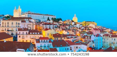 Lisszabon óváros sziluett Portugália naplemente város Stock fotó © joyr