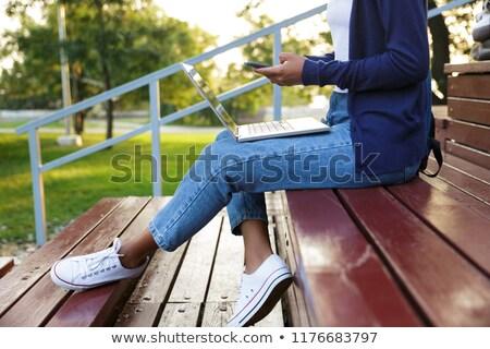 Сток-фото: сидят · улице · парка · шаги · используя · ноутбук