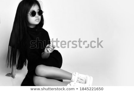 babies girls sitting on floor over white wall stock photo © lopolo