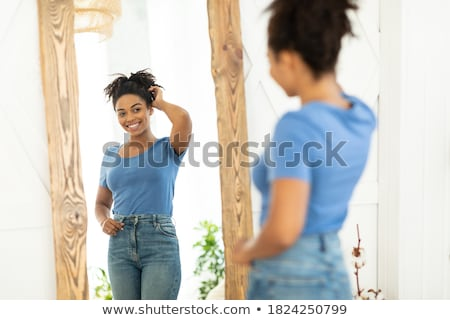 Afro woman with perfect slim body. Stock photo © NeonShot