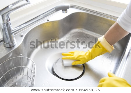 Woman Cleaning Kitchen Sink Stock photo © AndreyPopov