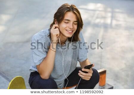 joyful young guy spending time at the skate park stock photo © deandrobot