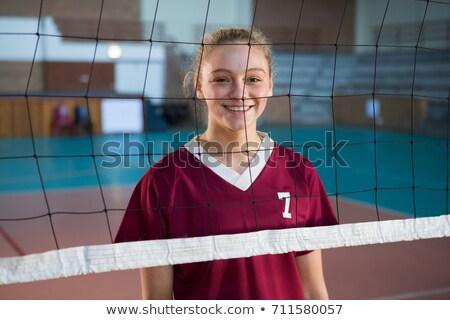 smiling teenage girl with volleyball stock photo © dolgachov