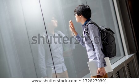 pensive young man looks in the mirror Stock photo © feedough