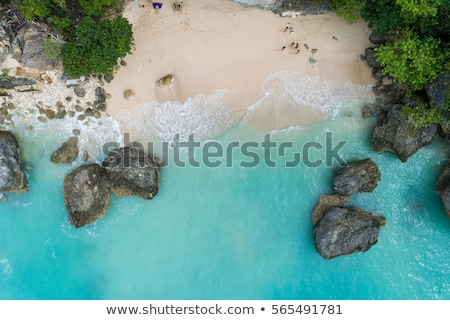 Top aerial view of beauty Bali beach. Empty paradise beach, blue sea waves in Bali island, Indonesia Stock photo © galitskaya