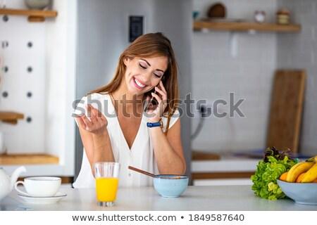 contemplating woman while having breakfast stock photo © kzenon