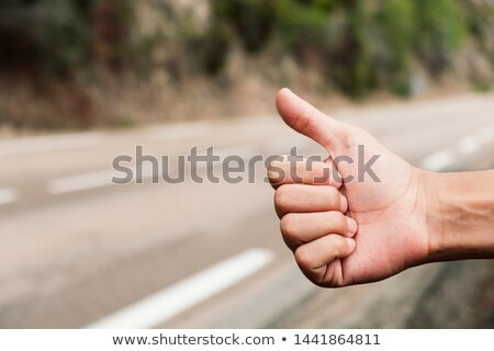young man hitchhiking on a secondary road Stock photo © nito