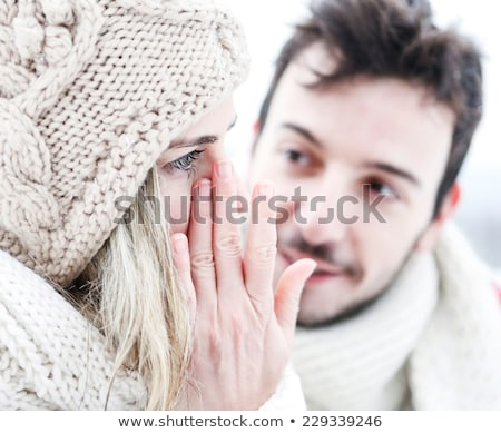 Stock fotó: Woman Crying Near Man In Winter And Wiping Tear Off Her Face
