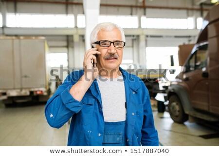 Senior technicus werkkleding bril raadpleging cliënt Stockfoto © pressmaster