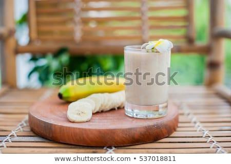 Banana cocktail and fresh bananas on a bamboo table Stock photo © galitskaya
