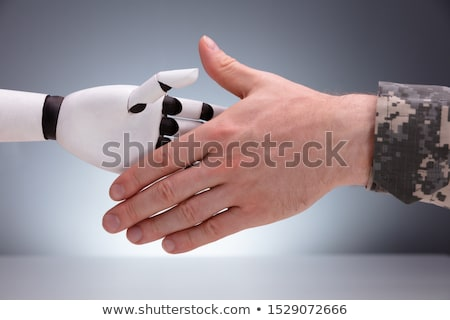 Close-up Of Military Man And Robot Shaking Hands Stock photo © AndreyPopov
