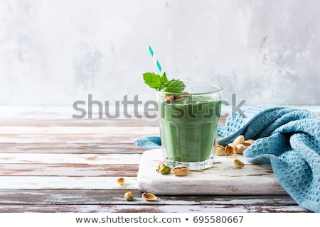 Banana cocktail and fresh bananas on the old wooden background Stock photo © galitskaya